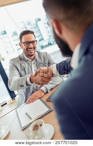 Two business colleagues shaking hands during meeting.Business partnership and meeting concept.