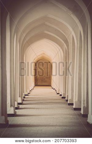 Arched hallway perspective at Mir-i-Arab medressa in Bukhara Uzbekisan.