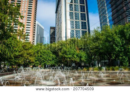 Water Fountain in Downtown Houston , Texas , USA Skyline Cityscape at Green Discovery Park sunny morning