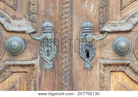 Old Wooden Door with Metal Handle Closeup