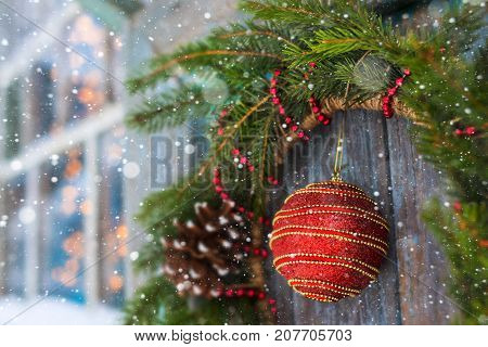 Christmas wreath on a door with a bump and a ball horizontal