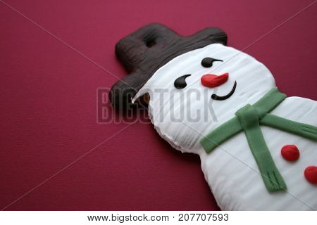 Christmas Gingerbread Snowman Handmade on purple background.