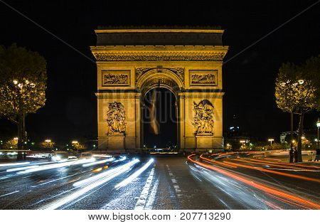 Arc de Triomphe in Paris, France. Night scene