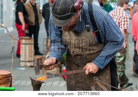Blacksmith Hammering The Iron
