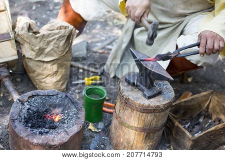 Blacksmith Hammering Hot Metal Arrow