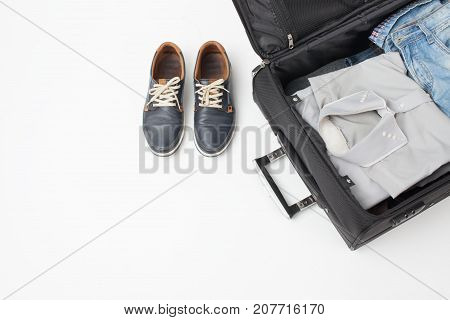Part Of The Suitcase And Shoes On White Background