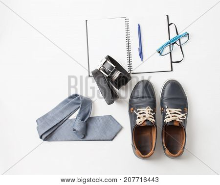 Set Of Men's Shoes And Accessories On White