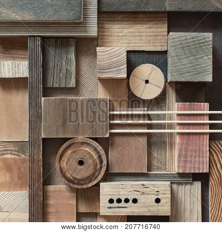 Abstract scrap wood blocks in collage background.