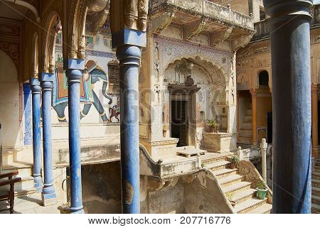 MANDAWA, INDIA - MARCH 31, 2007: Interior yard of the haveli in Mandawa, India. Snehi Ram Ladia haveli in Mandawa Rajasthan was built in mid 19th century.