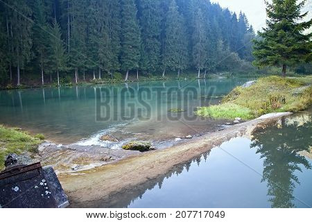 Ruzomberok - Cutkovska valley - water reservoir at the beginning of the valley. Water trees and mirror