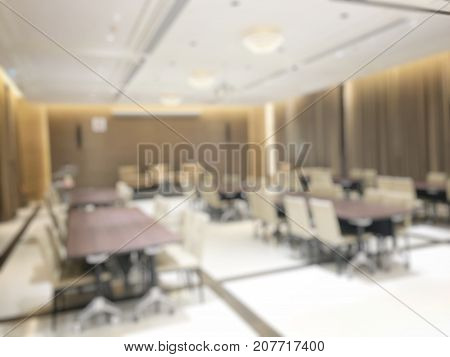 Blurred Image Of Empty Interior Of Conference Room, Meeting Room Prepare For Webinar. Blurry Nobody