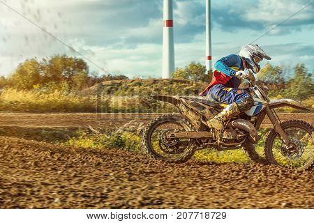 Extreme Motocross Mx Rider Riding On Dirt Track