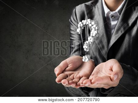 Cropped image of businessman in suit presenting multiple cubes in form of question mark in his hands. 3D rendering.