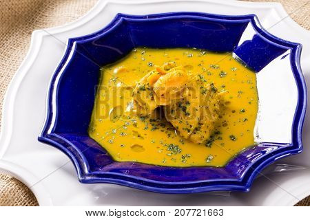 Pequi Fruit With Chicken Over A Wooden Table. Frango Com Pequi.