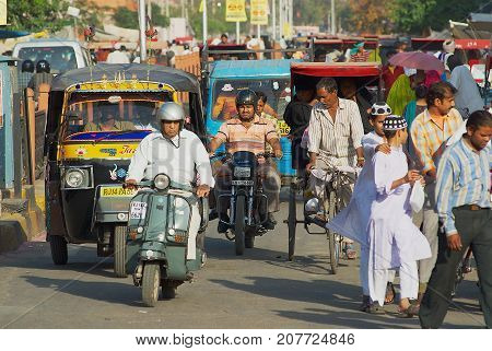 JAIPUR, INDIA - MARCH 29, 2007: Unidentified people move by the strew in a morning rush hour in Jaipur, India.