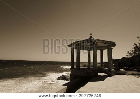 Vintage pagoda at dusk with sea view