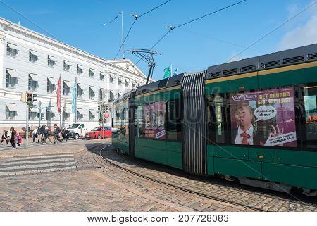 HELSINKI, FINLAND - SEPTEMBER 11:  Tramcar outside City Hall on September 11, 2017 in Helsinki, Finland. The City Hall opened in 1833.