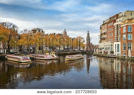 Amsterdam Netherlands - October 30 2016: The river Amstel with the Munttower in the background.