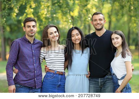 Five Women And Men Friends On Green Forest Background