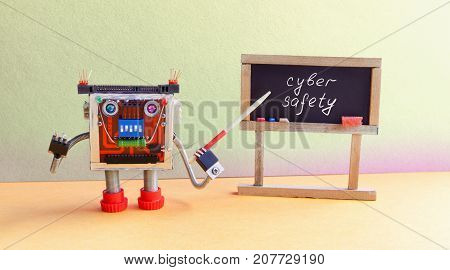 Cyber safety concept. Robot programmer lectures protection of computers Internet network. Friendly cyborg toy with pointer, black chalkboard handwritten warning text. Green yellow classroom interior