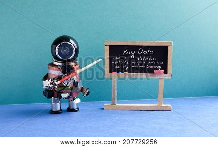 Big data machine learning concept. Futuric robot professor explains modern theory. Teacher with a pointer near chalkboard, main topics handwritten. Blue green interior classroom