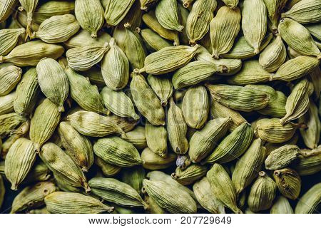 Background or texture with Pods of Green Cardamom.