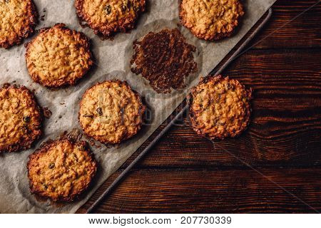 Homemade Oatmeal Cookies with Raisins on Parchment Paper. View from Above.