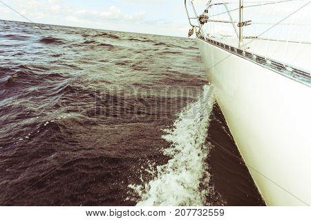 Yachting On Sail Boat Bow Stern Shot Splashing Water