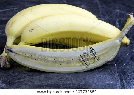 Banana Cut In Half With Nutrition Label On Black Marble