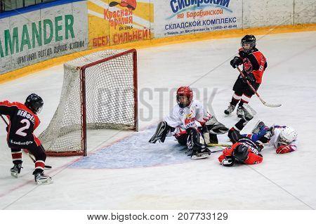Game Near Gate. Children Ice-hockey