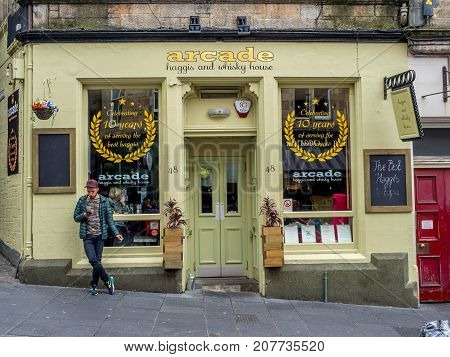 EDINBURGH, SCOTLAND - JULY 28: Arcade haggis and whisky house along Cockburn Street on July 28, 2017 in Edinburgh, Scotland. There are many pubs on in Edinburgh serving tourists beer and whisky.