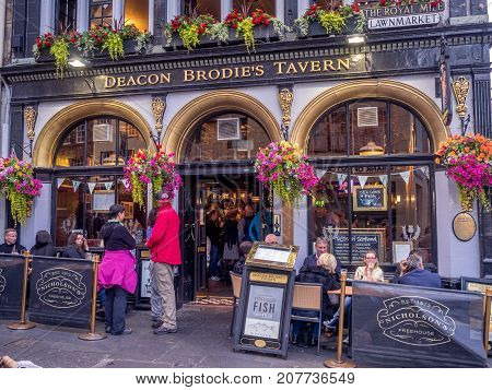 EDINBURGH, SCOTLAND - JULY 28: Deacon Brodie's Pub along the Royal Mile on July 28, 2017 in Edinburgh, Scotland. There are many such pubs on the Royal Mile serving tourists with whisky, beer, etc.