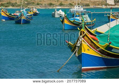 Colorful, old fisher boats are parking in harbor of Marsaxlokk, Malta