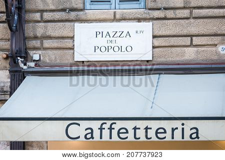 Piazza del Popolo sign on a building wall.