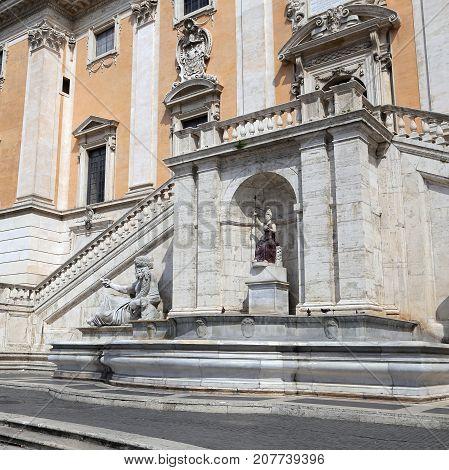 ROME ITALY - JUNE 11 2016: Statue of the Nile and the goddess Roma Piazza del Campidoglio - Rome Italy