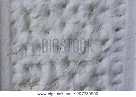 A gray wall with an uneven pattern. Beton coating. Plastered surface. Unusual background.