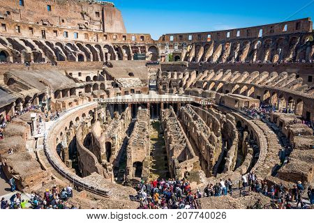 ROME ITALY - APRIL 24 2017. Inside view of The Colosseum with tourists sightseeing.