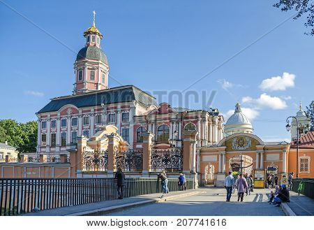 Saint Petersburg Russia - September 29 2017: Public entrance into the Saint Alexander Nevsky Lavra or Alexander Nevsky Monastery with the Church of the Annunciation of the Blessed Virgin and of the Holy Prince Alexander Nevsky.