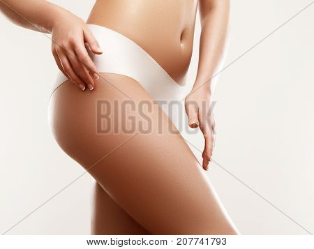 Woman Body. Closeup Of Beautiful Healthy Female With Hairless Smooth Soft Skin In White Bikini Panti