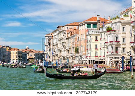 VENICE,ITALY - JULY 25,2017 : Gondolas on the Grand Canal in Venice on a summer day