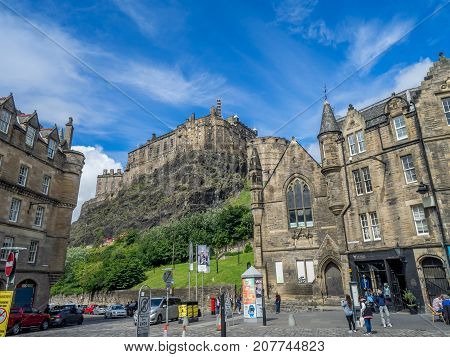 EDINBURGH, SCOTLAND - JULY 30: View of Edinburgh Castle from the Grassmarket ares of the Old Town on July 30 2017 in Edinburgh, Scotland. The famous Grassmarket  is a popular area of Edinburgh.