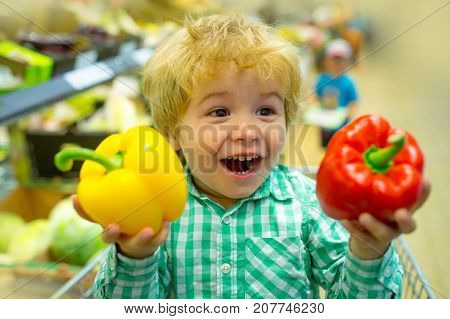 Happy Vegetables Child. Cute Kid In Supermarket Holds Bulgarian Sweet Pepper For Salad. Healthy Food