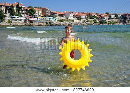 Happy child at sea beach in Sozopol Bulgaria