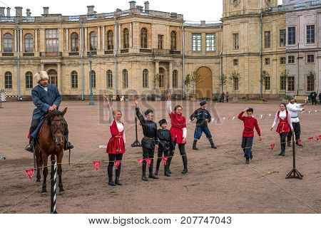 Gatchina St. Petersburg Russia - September 30 2017: Horse show of Cossacks on the parade ground of the Gatchina Palace. Young Cossacks greet the audience after the performance.
