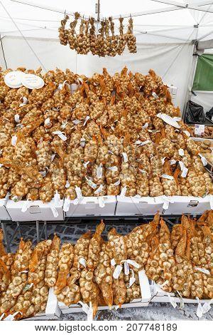HELSINKI FINLAND - SEPTEMBER 16 2017: Table full of onion bouquets in a market in Helsinki Finland on September 16 2017