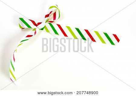 Hand Tied Silk Striped Holiday Ribbon In White, Green And Red, Isolated On White