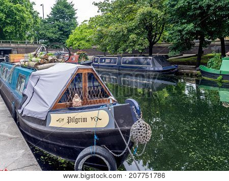 LONDON, UK - AUG 2: Little Venice water channles with colorful barges on August 2, 2017 in London, UK. Little Venice is a popular tourist area that is close to Paddington Station.