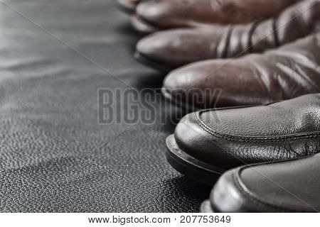 Second Hand Classic Leather Shoes on black leather background in Second Hand shop , Close up shot Shallow DOF