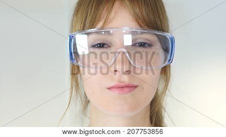Close Up Of Female Reseach Scientist, Doctor In Protective Glasses