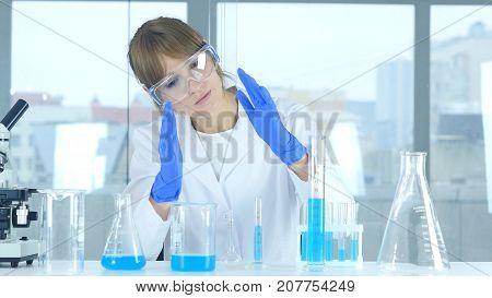 Female Research Scientist Imagining New Idea In Laboratory, Creative